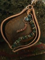 Wood pendant with copper and stone beads